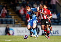 Photo: Richard Lane/Richard Lane Photography. Wycombe Wanderers v Brentford. Coca Cola Fotball League Two. Wycombe's Matt Harrold (lt) is challenged by Brentford's Marcus Bean.