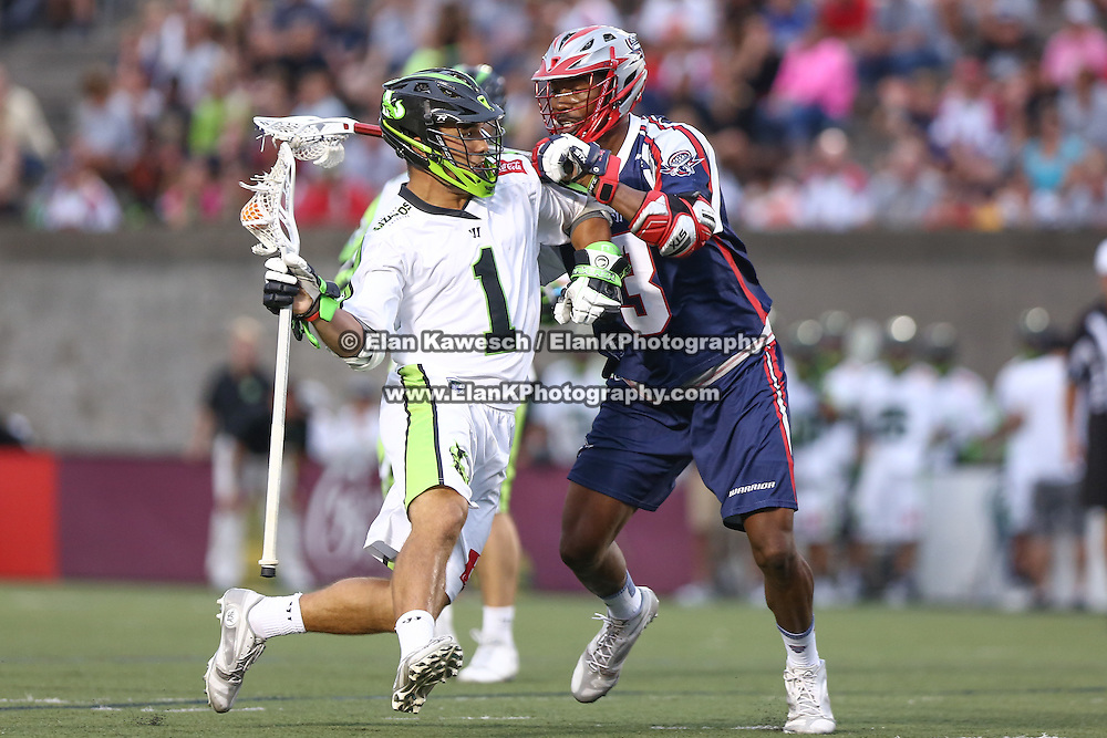 JoJo Marasco #1 of the New York Lizards controls the ball as he tries to get past Brendan Porter #3 of the Boston Cannons during the game at Harvard Stadium on July 19, 2014 in Boston, Massachusetts. (Photo by Elan Kawesch)