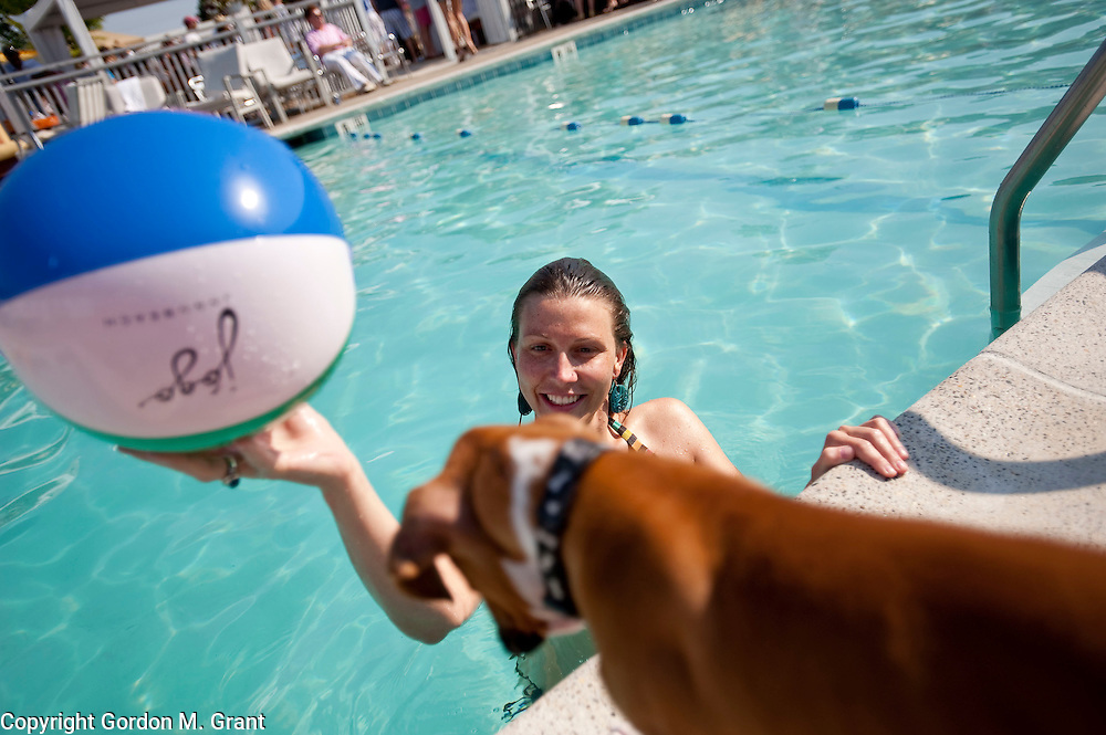 Southampton - June 27, 2009: Alex Fairey with her dog Lucky  poolside at the Day & Night Pool Club, Saturday, June 27, 2009 in Southampton, NY..(Photo by Gordon M. Grant)
