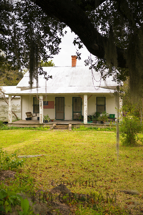 Simple modest Cajun cottage style house along the Mississippi at Baldwin in Louisiana, USA