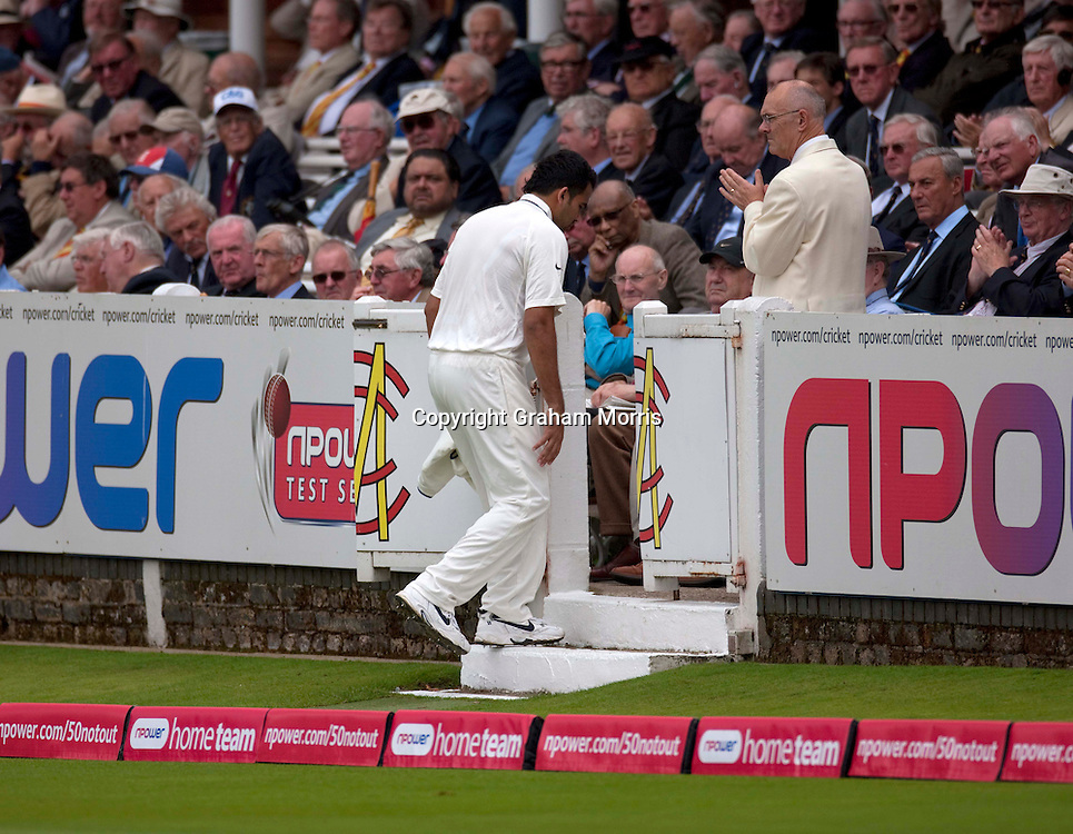 Bowler Zaheer Khan limps off into the pavilion holding his hamstring during the first npower Test Match between England and India at Lord's Cricket Ground, London.  Photo: Graham Morris (Tel: +44(0)20 8969 4192 Email: sales@cricketpix.com) 21/07/11