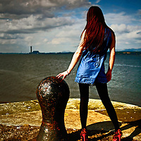 Young Woman in blue dress  at quayside