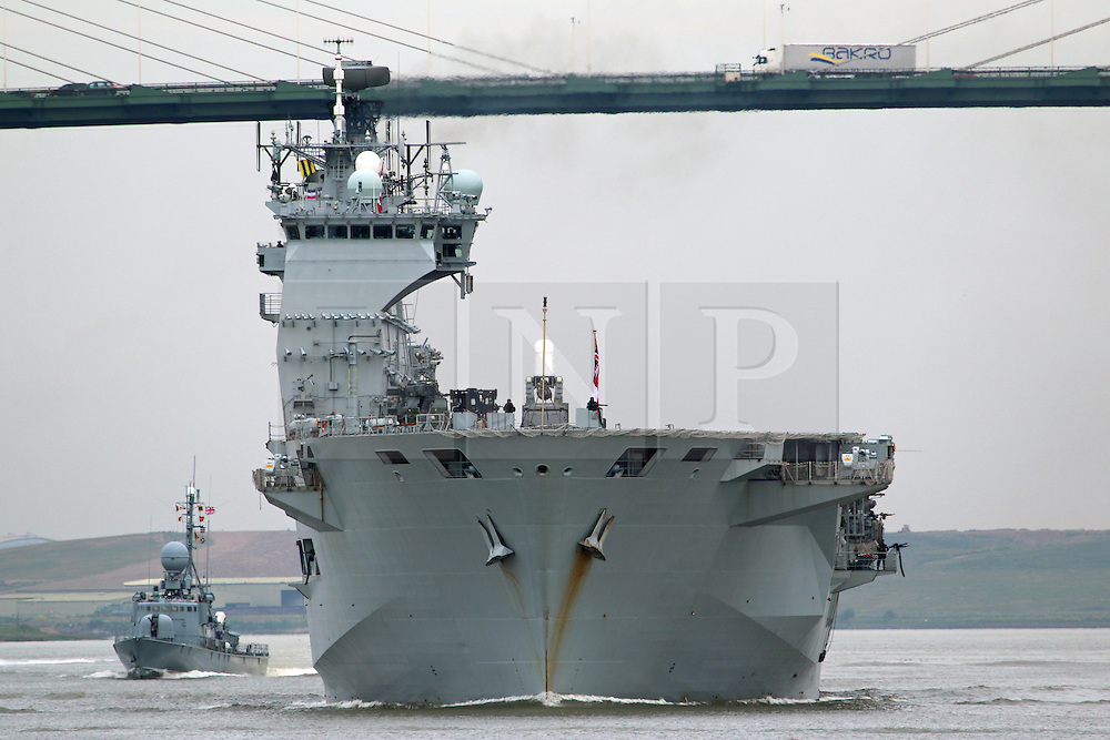 © Licensed to London News Pictures. 11/05/2015.  HMS Ocean pictured a the QEII Bridge, Dartford, on the River Thames. HMS Ocean has left London after a five day visit in which she helped commemorate the 70th anniversary of VE Day. The Royal Navy's largest warship was moored at Greenwich for the duration of her visit and departed this morning just after 6am. Credit : Rob Powell/LNP