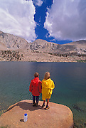 Kids fishing at Cottonwood Lake, John Muir Wilderness, Sierra Nevada Mountains, California USA