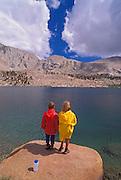 Kids fishing at Cottonwood Lake, John Muir Wilderness, Sierra Nevada Mountains, California USA