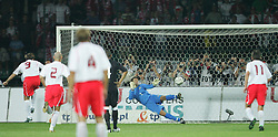 WARSAW, POLAND - WEDNESDAY, SEPTEMBER 7th, 2005: Despite doing a 'Dudek' Wales' goalkeeper Danny Coyne is beaten by Poland's Maciej Zurawski from the penalty spot during the World Cup Group Six Qualifying match at the Legia Stadium. (Pic by David Rawcliffe/Propaganda)