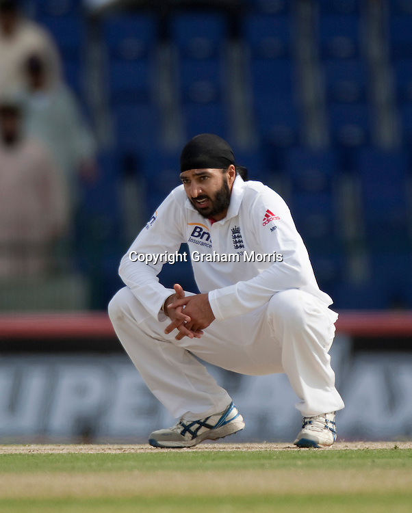 Monty Panesar (after missing 29 Tests) during the second Test Match between Pakistan and England at the Zayed Cricket Stadium, Abu Dhabi, UAE. Photo: Graham Morris/cricketpix.com (Tel: +44 (0)20 8969 4192; Email: graham@cricketpix.com)  25/01/12