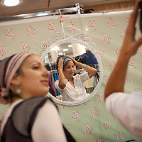 An Orthodox jewish woman tries on a head scarf during a fashion fair for Orthodox women in Jerusalem.