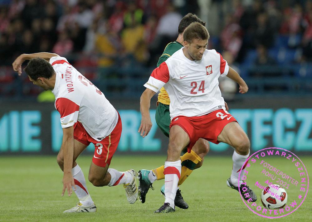KRAKOW 07/09/2010.FOOTBALL INTERNATIONAL FRIENDLY.POLAND v AUSTRALIA.Dariusz Pietrasiak /R/ and Grzegorz Wojtkowiak  of Poland ..Fot: Piotr Hawalej / WROFOTO