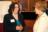 Julie Barhorst of Horizon Payroll Solutions (left) and Debby Sibert of WCH Marketing Communications during a Dayton Area Chamber of Commerce Business After Hours at the NCR Country Club in Kettering, Wednesday, July 25, 2012.  The Chamber will hold the 2012 Chamber Challenge, their 20th annual golf tournament and silent auction, at the NCR Country Club in September.