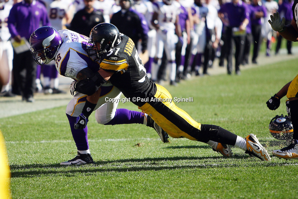 Minnesota Vikings fullback Naufahu Tahi (38) gets tackled while running the ball by Pittsburgh Steelers linebacker James Farrior (51) during the NFL football game, October 25, 2009 in Pittsburgh, Pennsylvania. The Steelers won the game 27-17. (©Paul Anthony Spinelli)