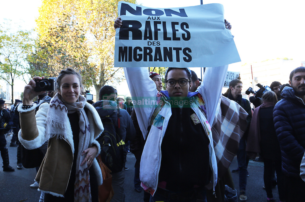 """People protest in front of a line of riot police in a street of Paris, France, on October 31, 2016 during a police operation aiming at evacuating one of the camps sprouting up around the French capital where migrants live in squalid conditions. An operation of """"administrative control"""" was underway on early October 31 in the Jaures/Stalingrad quarter before a future evacuation, whose date has not yet been set, according to a police source. The makeshift camp on the outskirts of the 10th and 19th arrondissements in the north of the capital numbers today 2,500 people, according to the City of Paris. Photo by Somer/ABACAPRESS.COM"""