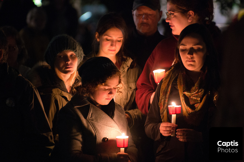 People hold candles in front of the National War Memorial during a vigil for Cpl. Nathan Cirillo. October 25, 2014.
