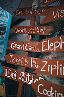 Chiang Mai, Thailand -- May 19, 2017: Signs for travelers in the Old Town.