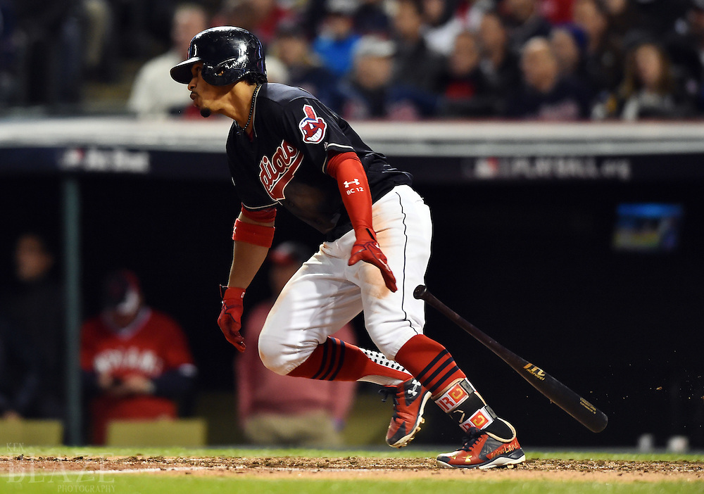 Oct 25, 2016; Cleveland, OH, USA; Cleveland Indians shortstop Francisco Lindor hits a single against the Chicago Cubs in the third inning in game one of the 2016 World Series at Progressive Field. Mandatory Credit: Ken Blaze-USA TODAY Sports