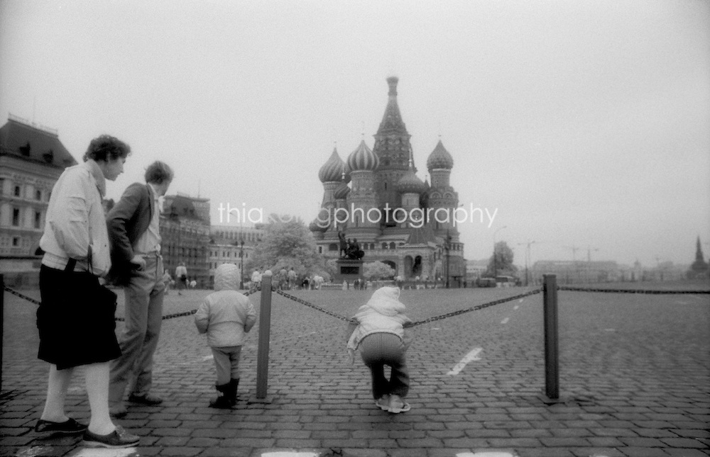 Family of four (tourists?) linger in Red Square, Moscow, Russia