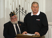 Shortly after returning home from the journey to Vietnam, U.S. Army veteran Joe Caley, of Tallmadge, is asked to speak at his community's veteran's day program at the Historical Church in the circle.   Caley asked those who gathered to consider peace as a solution, instead of war.  (Laura Fong Torchia / Special to the Beacon Journal)