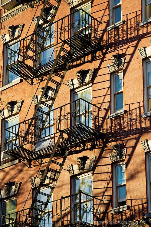 Fire Escape casts shadows in the evening sun over Generic New York City Apartment Buildings