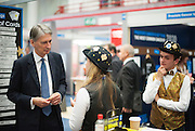 © Licensed to London News Pictures. 29/09/2014. Birmingham, UK. Foreign Secretary Philip Hammond visits trade stands.  The Conservative Party Conference in Birmingham 29th September 2014. Photo credit : Stephen Simpson/LNP