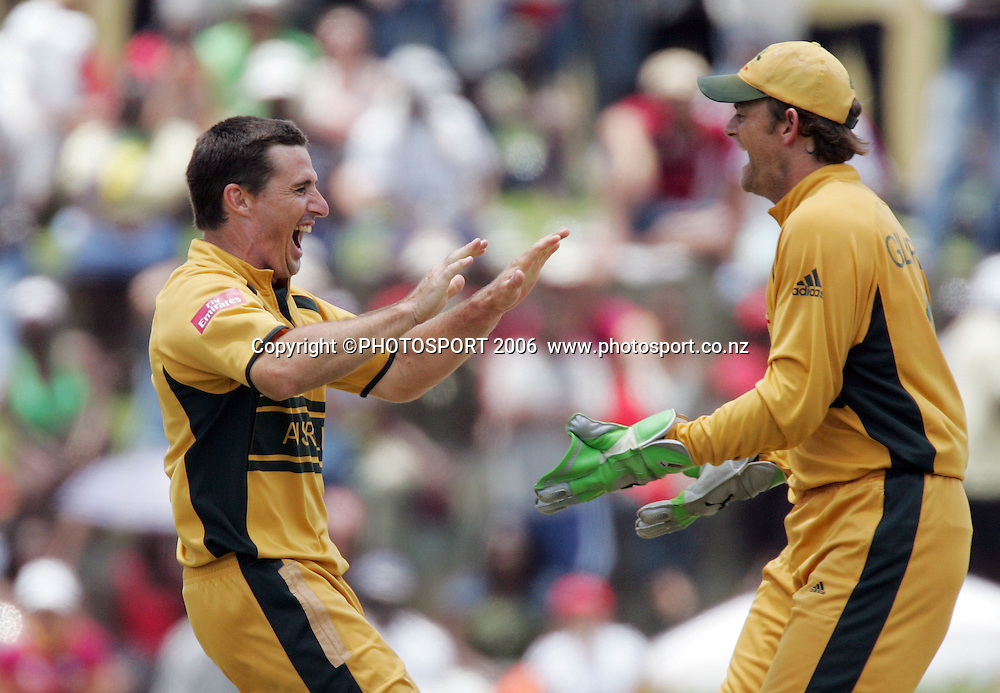 Australian spin bowler Brad Hodge (L)  celebrates with Adam Gilchrist (R) after dismissing Brian Lara at the Super 8 Cricket World Cup match, West Indies vs Australia at the Sir Vivian Richards Cricket Ground in Antigua, West Indies on Wednesday 28 March 2007. Australia batted first and scored 322 for 6. Play continued today after rain stopped play yesterday. Australia won by 103 runs. Photo: Andrew Cornaga/PHOTOSPORT<br />