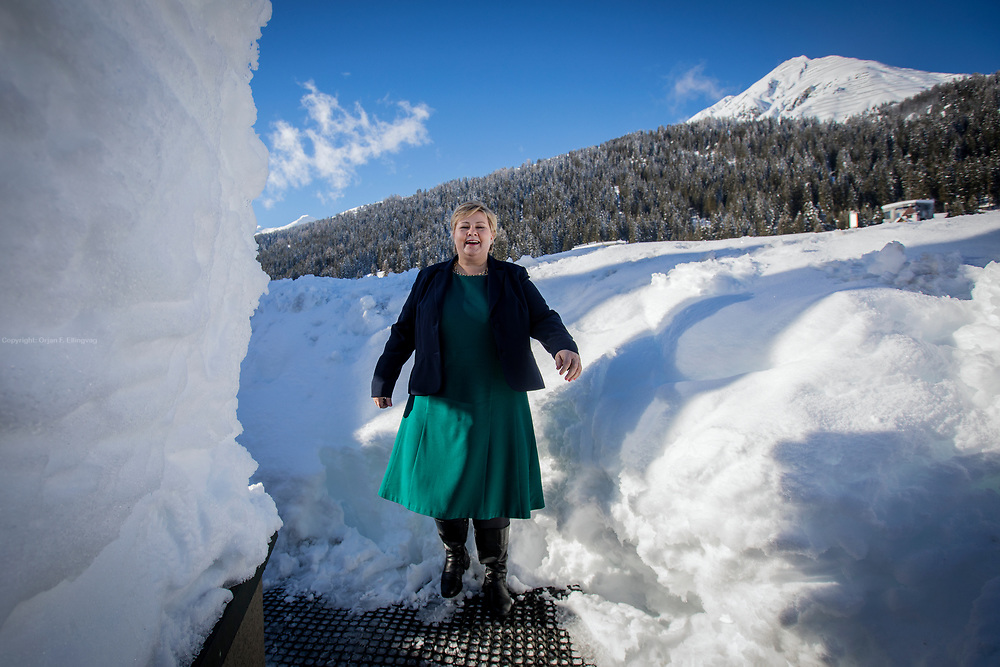 Norwegian Prime Minister Erna Solberg on her way from a TV-interview to more meetings on day two of the World Economic Forum in Davos.