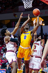NORMAL, IL - December 07: Tyzhaun Claude gets the ball to the glass when doubled by Jaycee Hillsman and Ricky Torres during a college basketball game between the ISU Redbirds and the Morehead State Eagles on December 07 2019 at Redbird Arena in Normal, IL. (Photo by Alan Look)