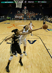 UVA's Lyndra Littles (1) reaches for a loose ball against Wake Forest.  The Cavaliers defeated the Demon Deacon 77-71 on January 11, 2007 for their first ACC win in the John Paul Jones Arena in Charlottesville, VA.<br />