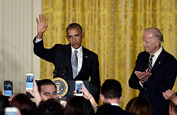 October 12, 2016 - Washington, District of Columbia, United States of America - United States President Barack Obama (L) waves as Vice President Joe Biden  looks on during a reception for Hispanic Heritage Month in the East Room of the White House on October 12, 2016 in Washington, DC. .Credit: Olivier Douliery / Pool via CNP (Credit Image: © Olivier Douliery/CNP via ZUMA Wire)