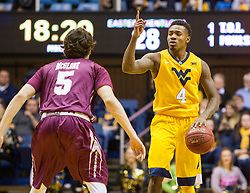 Dec 21, 2015; Morgantown, WV, USA; West Virginia Mountaineers guard Daxter Miles Jr. (4) calls out a play during the second half against the Eastern Kentucky Colonels at the WVU Coliseum. Mandatory Credit: Ben Queen-USA TODAY Sports