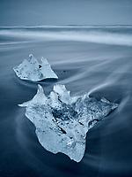 Icebergs on Jökulsárlón black sand beach. Southeast Iceland.