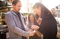(L-R) Ted Grubb, 30, Alexa Andrzejewski, 27, and Soraya Darabi, 27, eat cherries from Bi-Rite Market in the Mission District, in San Francisco, Ca., on Wednesday, May 25, 2011. They are three entreprenuers who developed the iPhone app, Foodspotting.