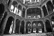 The destroyed interior of the Bosnian National Library where thousands of priceless books and documents burned after Bosnian Serb gunners fired incendiary shells at the building in 1992, photographed here during the final days of the siege of the city, Sarajevo, Bosnia and Herzegovina, February 1996. PHOTO BY ROGER M. RICHARDS