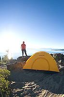 Young man hiking above Lake Tahoe, CA.