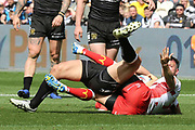 Opposition players grapple on the ground during the Betfred Super League match between Hull FC and Hull Kingston Rovers at Kingston Communications Stadium, Hull, United Kingdom on 19 April 2019.