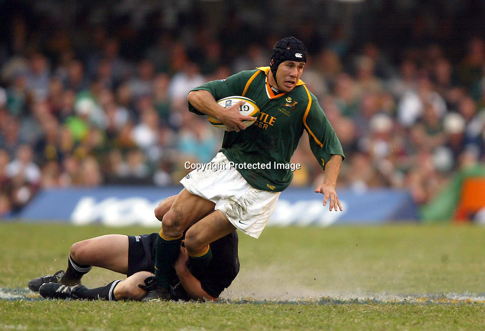 10 August 2002, ABSA Stadium Durban, Tri - Nations, Rugby Union. New Zealand v South Africa. De Wet Barry is stopped by Aaron Mauger. The All Blacks defeated the Springboks, 30-23.<br />Pic: Photosport