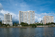 YTowring condos line the edge of the Ala Wai Canal in Honolulu.