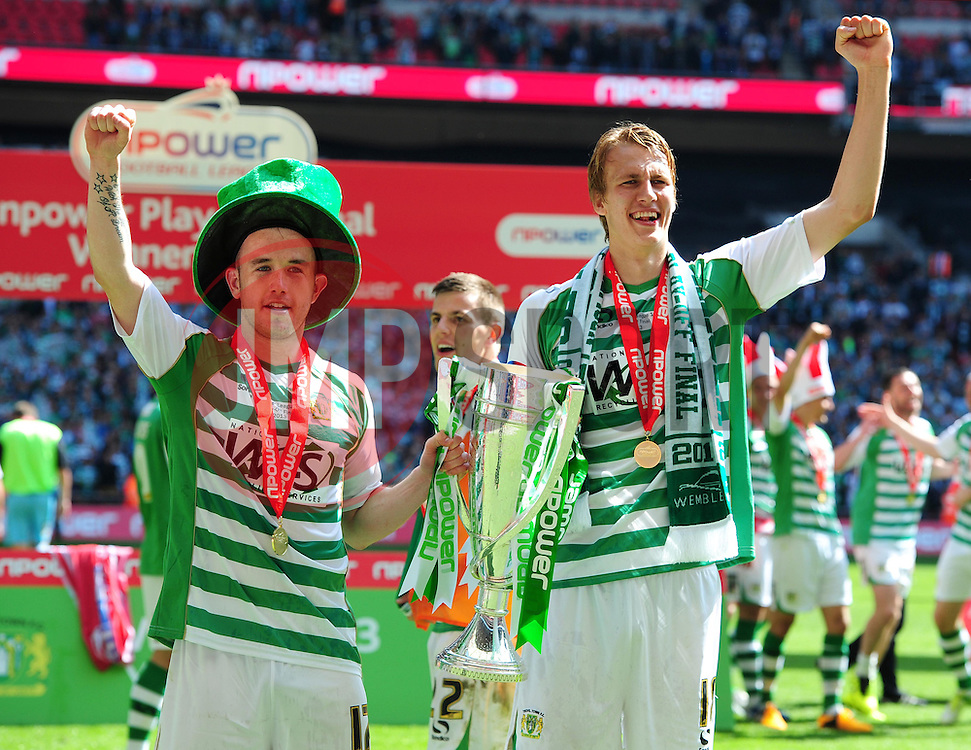 Yeovil Town's Paddy Madden (left) and Yeovil Town's Dan Burn (right) celebrate with the trophy - Photo mandatory by-line: Joe Meredith/JMP - Tel: Mobile: 07966 386802 19/05/2013 - SPORT - FOOTBALL - LEAGUE 1 - PLAY OFF - FINAL - Wembley Stadium - London - Brentford V Yeovil Town