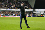 Millwall fan on the pitch celebrating during the The FA Cup fourth round match between Millwall and Everton at The Den, London, England on 26 January 2019.