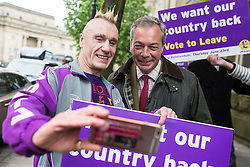 © Licensed to London News Pictures . 25/05/2016 . Bolton , UK . A man poses for a selfie with NIGEL FARAGE . The UKIP referendum bus tour , campaigning for a UK Brexit , lead by Nigel Farage , in Victoria Square , Bolton . Photo credit : Joel Goodman/LNP