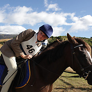 ALex Forsyth riding Nobel Secret Wish prepares for the Dressage event at the Wakatipu One Day Horse Trials,  Queenstown, Otago, New Zealand. 15th January 2012. Photo Tim Clayton