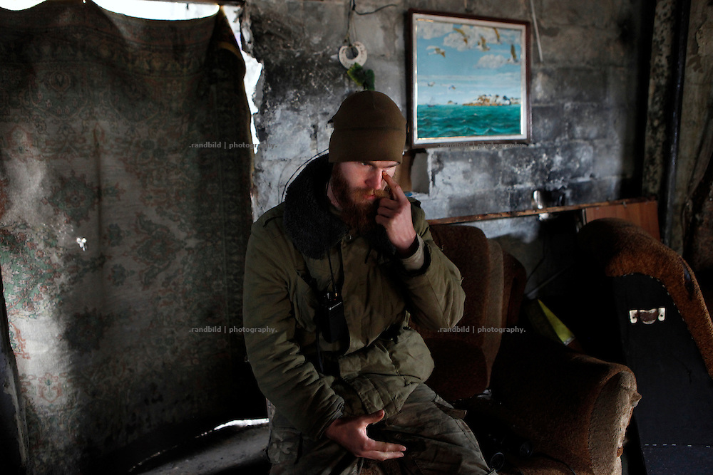 Craig kills time in his position in a private house at the donetsk frontline.<br />