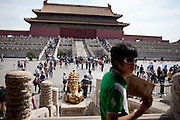 "Tourists and visitors inside  ""The Forbidden City"" which was the Chinese imperial palace from the Ming Dynasty to the end of the Qing Dynasty. It is located in the middle of Beijing, China. Beijing is the capital of the People's Republic of China and one of the most populous cities in the world with a population of 19,612,368 as of 2010."