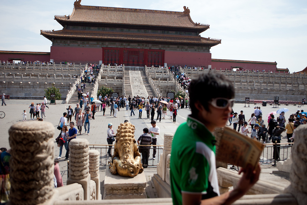 """Tourists and visitors inside  """"The Forbidden City"""" which was the Chinese imperial palace from the Ming Dynasty to the end of the Qing Dynasty. It is located in the middle of Beijing, China. Beijing is the capital of the People's Republic of China and one of the most populous cities in the world with a population of 19,612,368 as of 2010."""