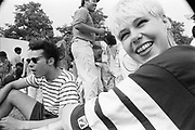 Happy faced female at the Moss Side Carnival, Alexandra Park, Manchester 1989