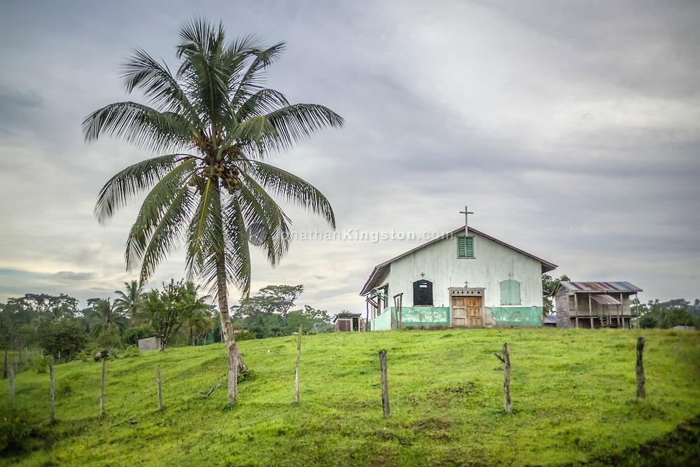 Church next to a palm tree in Krin Krin, Nicaragua.