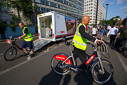 © Licensed to London News Pictures. 09/07/2015. London, UK. An empty Boris bike station is filled with new bikes outside Waterloo Station as tube strike shuts down the entire London Underground network on Thursday, July 9, 2015. The strike called by RMT, TSSA and Unite unions is a 27-hour stoppage by about 20,000 Tube staff and shuts down the entire London Underground network. Photo credit: Tolga Akmen/LNP