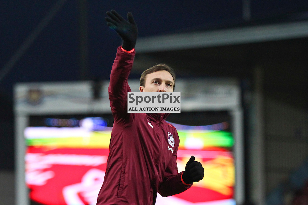 Mark Noble of West Ham United waves to fans during the warm up before the Barclays Premier League game against Manchester City.