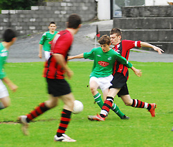 Westport United's Captain James O' Donnell breaking up the Claremorris attacks...Pic Conor McKeown