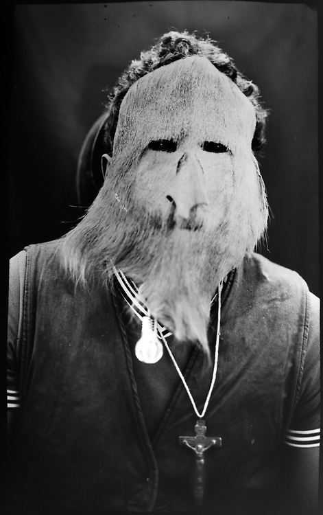 """In this June 12, 2017 photo taken with a 19th century style box camera, 20-year-old Alexio Marveli poses for a portrait in the Sinakara Valley, during the Qoyllur Rit'i festival. Marveli is dressed as the mystical character, """"El Auqui"""", a wise old man and protector. It coincides with the reappearance of the star cluster Pleiades in the Southern Hemisphere, signaling the abundance of the harvest season."""