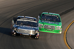 July 12, 2018 - Sparta, KY, U.S. - SPARTA, KY - JULY 12: Ben Rhodes (41) ThorSport Racing Ford F-150 works his way under the truck of Noah Gragson (18) Safelite Auto Glass Kyle Busch Racing Toyota Tundra as the two battle for the lead of the NASCAR Camping World Truck Series Buckle Up In Your Truck 225 on July 12th, 2018, at Kentucky Speedway in Sparta, Kentucky. (Photo by Michael Allio/Icon Sportswire) (Credit Image: © Michael Allio/Icon SMI via ZUMA Press)